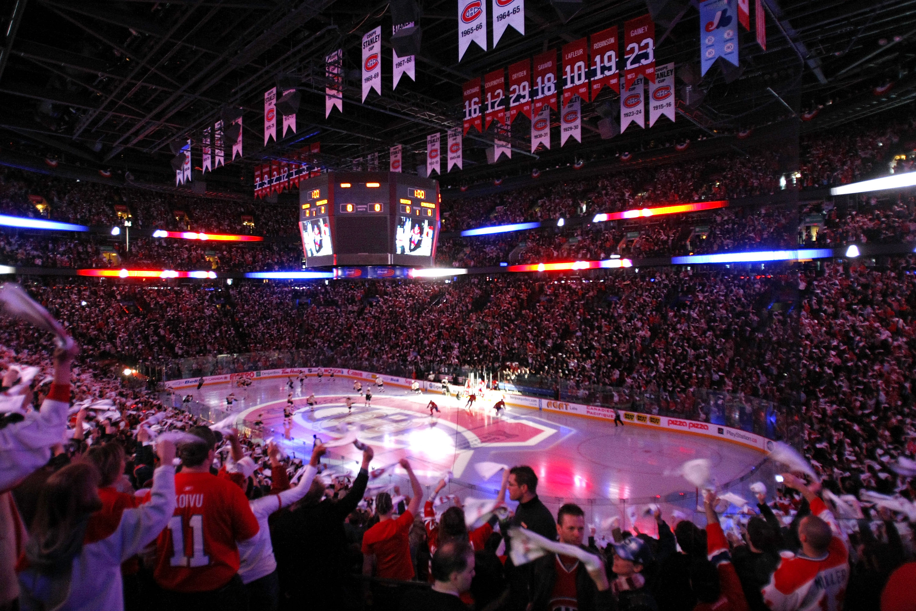 MONTREAL - APRIL 10: Fans cheer as the Montreal Canadiens take to the ice to face the Boston Bruins during Game One of the 2008 NHL Eastern Conference Quarterfinals at the Bell Centre April 10, 2008 in Montreal, Quebec, Canada. (Photo By Dave Sandford/Getty Images)