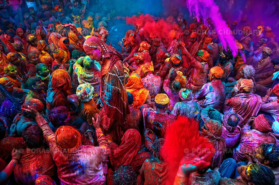 The festival of Holi is a religious festival. People sing bhajans of Radha and Lord Krishna on this day and it marks the beginning of Spring Season in india. Here you can see a gathering of people singing folk songs and dancing while people throwing colors on them during Holi (Festival of Colors), India…